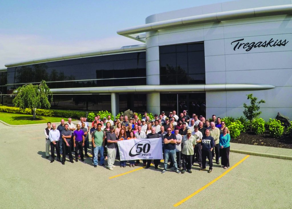 Employees in front of Tregaskiss holding 50th anniversary sign