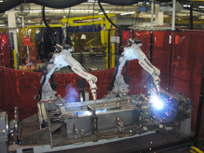 Image of automatic robots actively welding