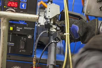 Image of welder checking MIG gun connection to the welding machine
