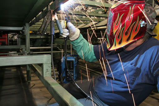 Image of person welding in a GMAW application