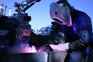 Image of two welders, showing  self-shielded flux-cored arc welding (FCAW-S) g application, welding