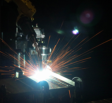 Image of a robotic welding application with sparks