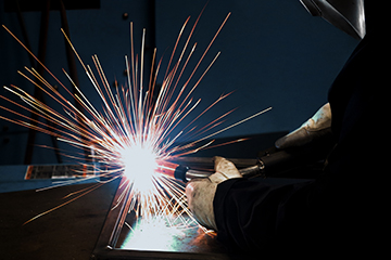 Image of a welder in a semi-automatic application