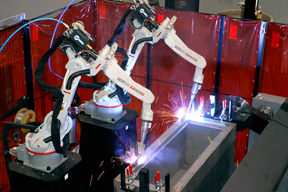 Image of two robots in a welding cell, set-up properly