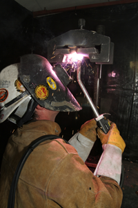 Image of a welder using a self-shielding application